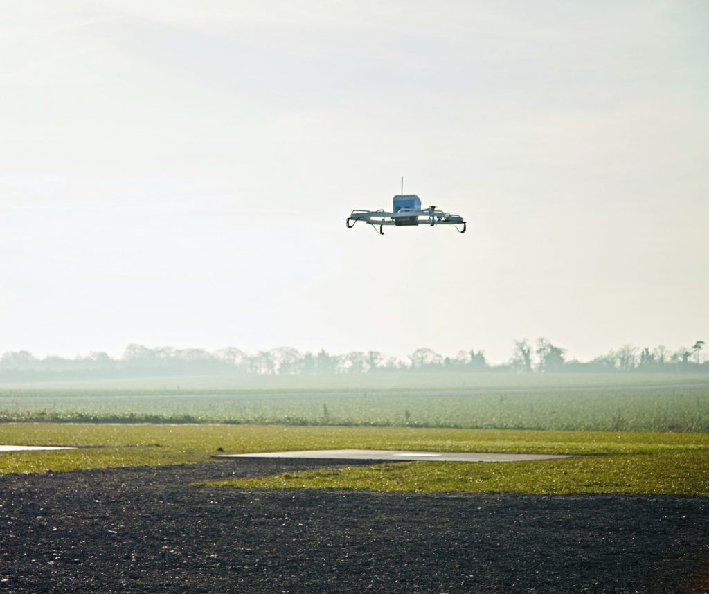 An Amazon Prime Air drone flies in Cambridgeshire, United Kingdom, in 2016. The company says it is still pushing ahead with plans to use drones for quick deliveries. It has drone development centers in the U.S., Austria, France, Israel and the United Kingdom.