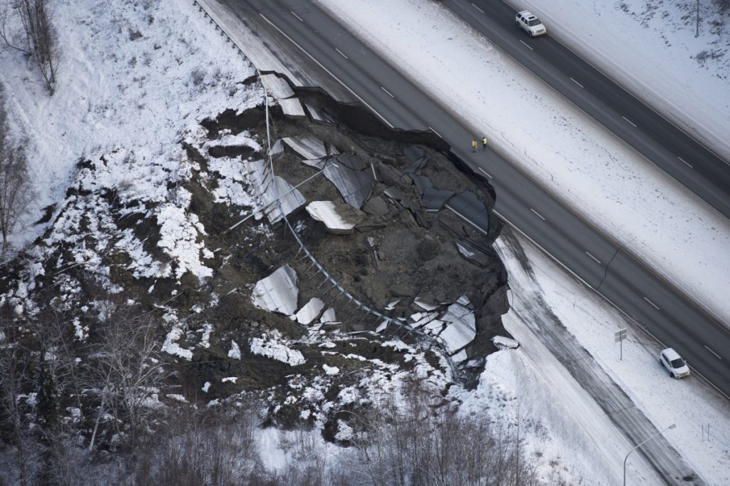 This aerial photo shows damage at the Glenn Highway near Mirror Lake after earthquakes in the Anchorage area of Alaska on Friday. Scientists at the U.S. Geological Survey say a 4.6-magnitude aftershock occurred shortly after 7 a.m. Tuesday and was felt in Anchorage.
