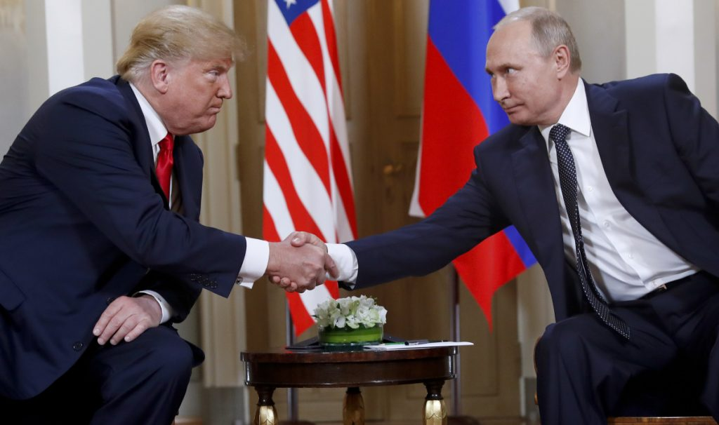 President Trump and Russian President Vladimir Putin shake hands at the beginning of a meeting in Helsinki, Finland, on July 16, 2018.