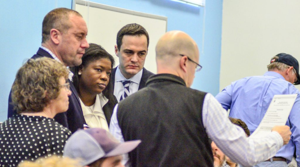A campaign recount specialist for U.S. Rep. Bruce Poliquin, Kim Pettingill, left, and attorney Josh Tardy, along with U.S. Rep.-elect Jared Golden's campaign attorneys Ruthzee Louijeune, John Giese and Ben Grant, scrutinize a ballot during the recount on Thursday in the Elkins Building in Augusta.