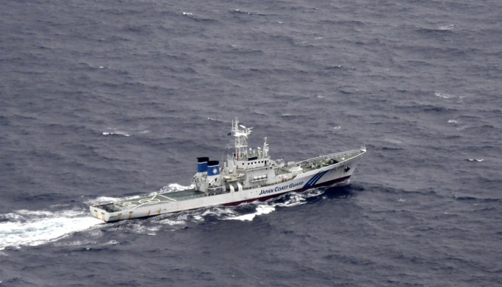 A Japanese Coast Guard ship is seen at sea during a search and rescue operation for missing crew members of a U.S. Marine refueling plane and fighter jet off Muroto, Kochi prefecture, southwestern Japan, on Thursday.