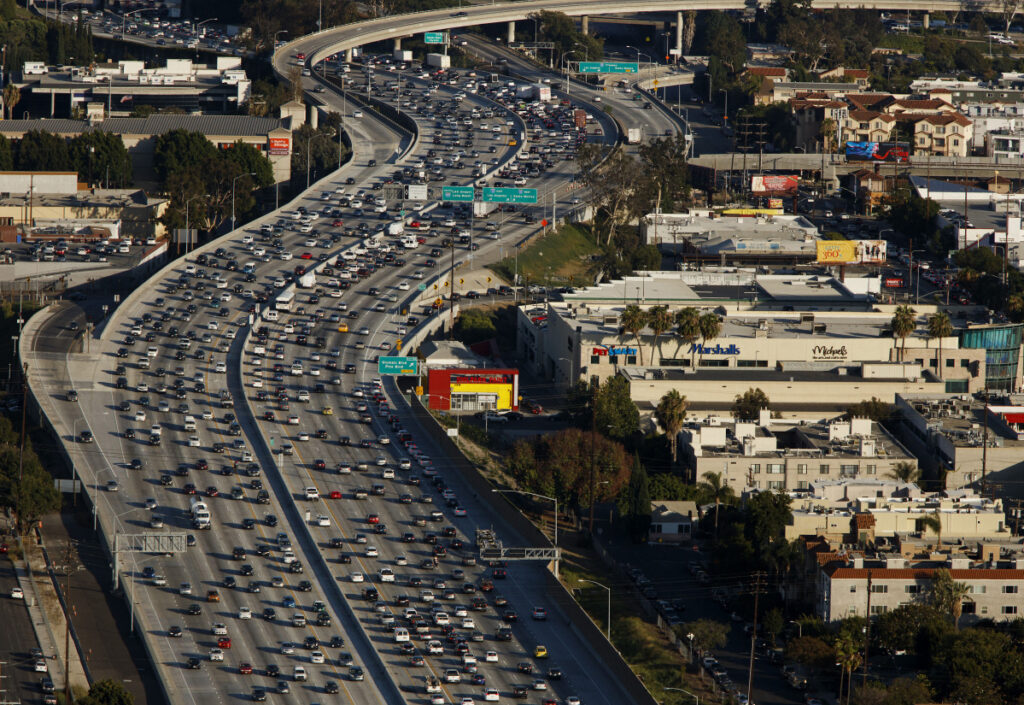 Vehicles clog the Interstate 405 freeway in Los Angeles in 2015. President Trump and Democrats want to pursue major public-works legislation in 2019, but there's no consensus on how to pay for it.