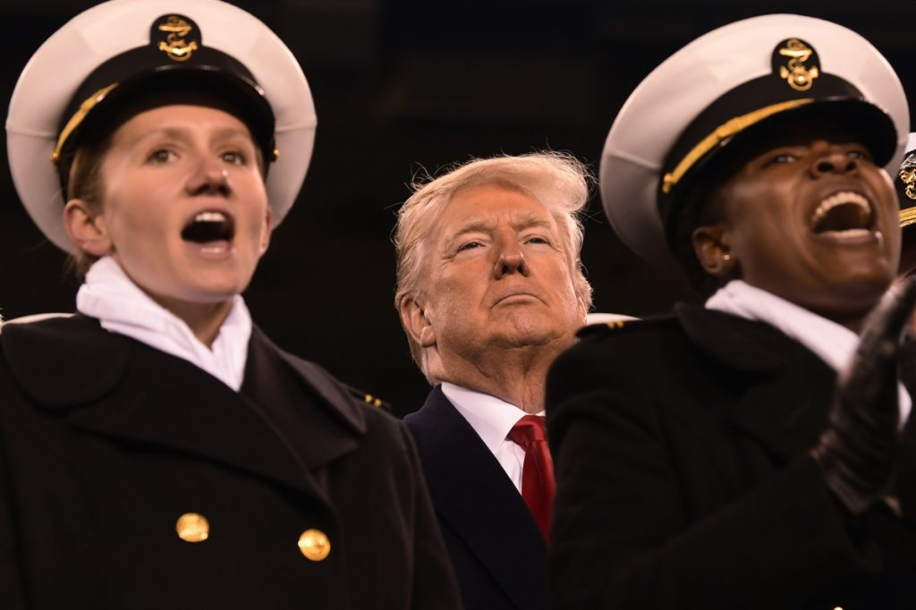 President Trump attends the Army-Navy football game in Philadelphia on Saturday, a day after court filings tied him to a federal crime.