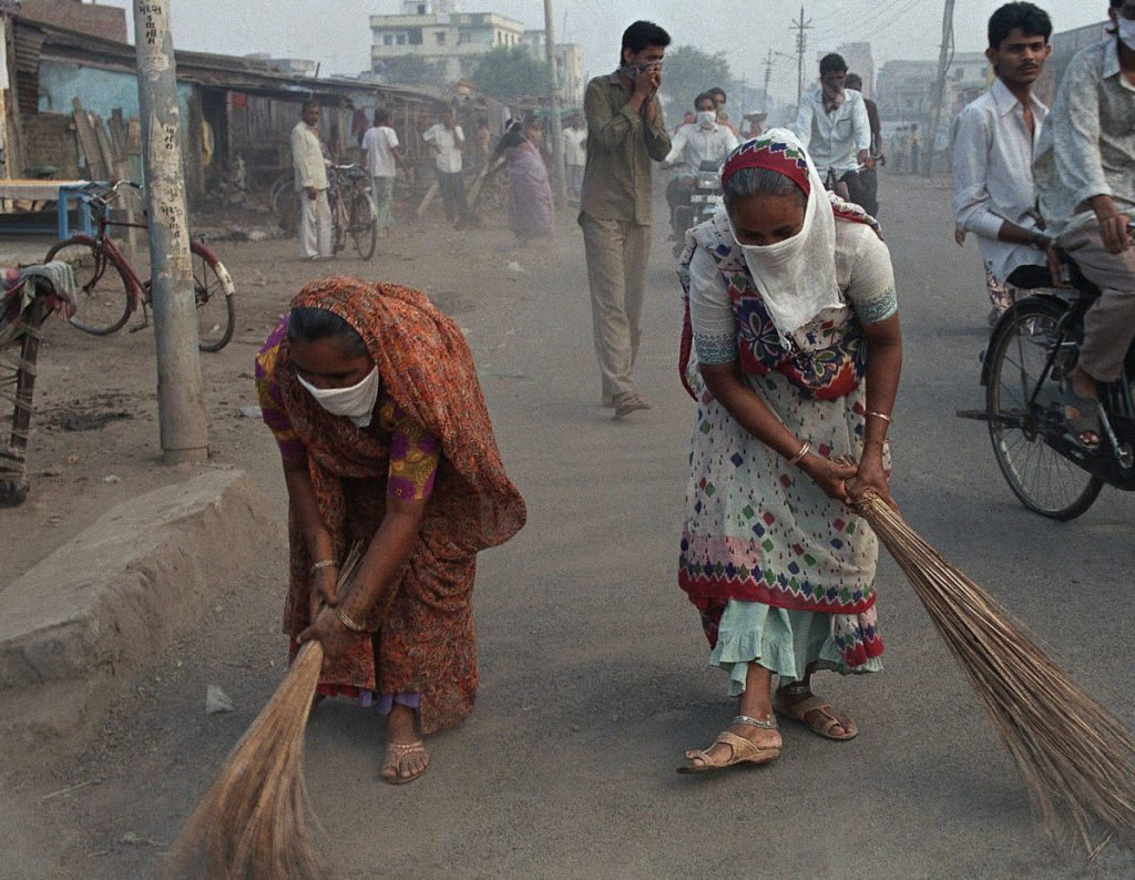 Women in Surat, India, sweep the streets during a plague epidemic in 1994. While rat-associated plague can still be found, it is largely under control.