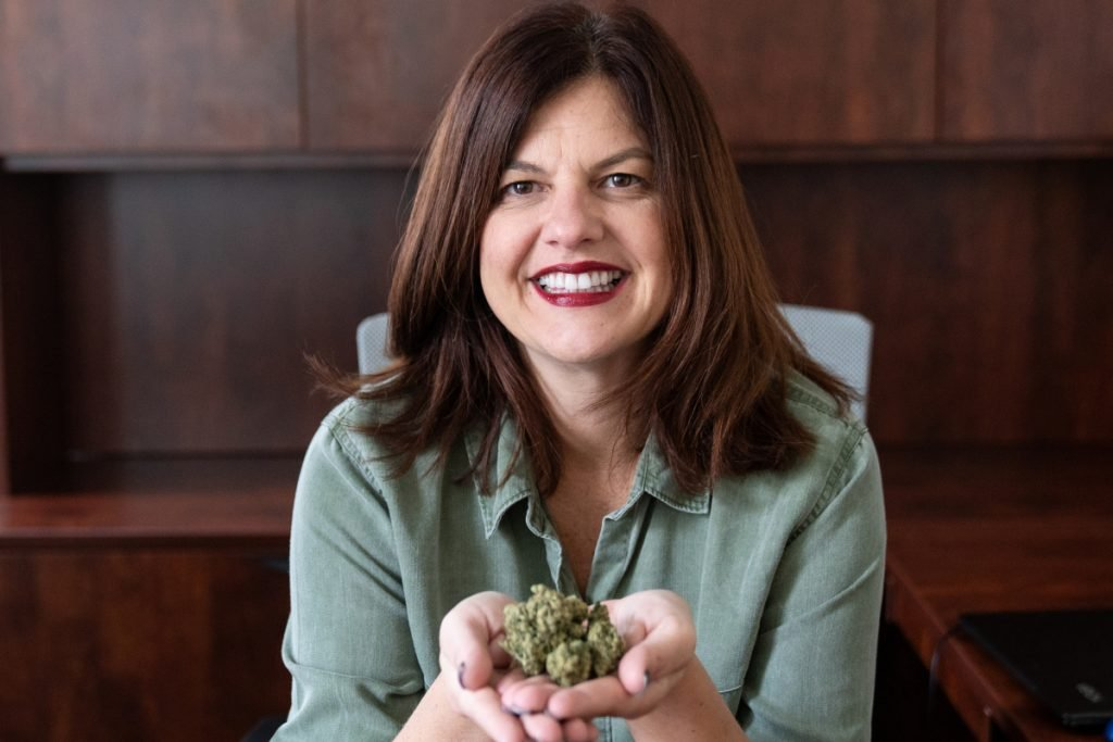 Chris Visco, president and CEO of TerraVida Holistic Center, holds Copper Chem Marijuana Bud by Ilera Healthcare at her office in Abington, Pa. Visco is also a medical marijuana patient, taking it for migraines and insomnia.