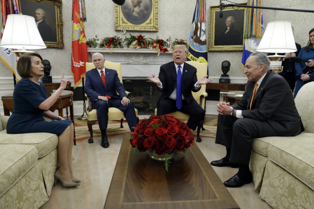 President Trump and Vice President Mike Pence meet with Senate Minority Leader Chuck Schumer, D-N.Y., and House Minority Leader Nancy Pelosi, D-Calif., in the Oval Office of the White House on Tuesday in Washington. The meeting quickly became testy.