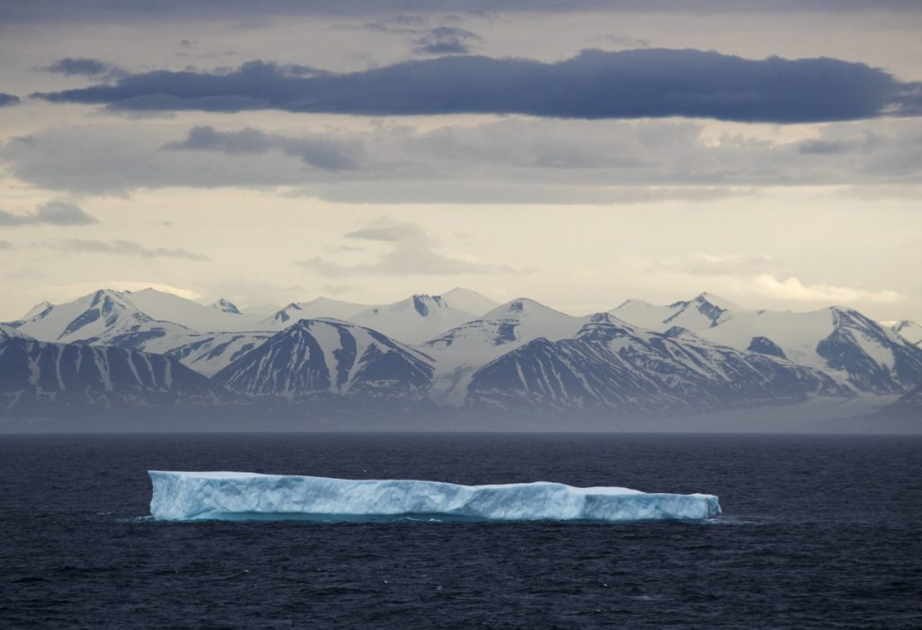 An iceberg in the Canadian Arctic Archipelago in July 2017. A National Oceanic and Atmospheric Administration report finds record low winter sea ice the Arctic and increased toxic algal blooms.