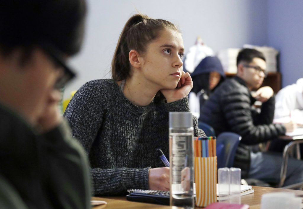 Hazel Ostrowski attends class at Franklin High School on Wednesday in Seattle. She and other students wore activity monitors to discover whether a later start to the school day would help them get more sleep.