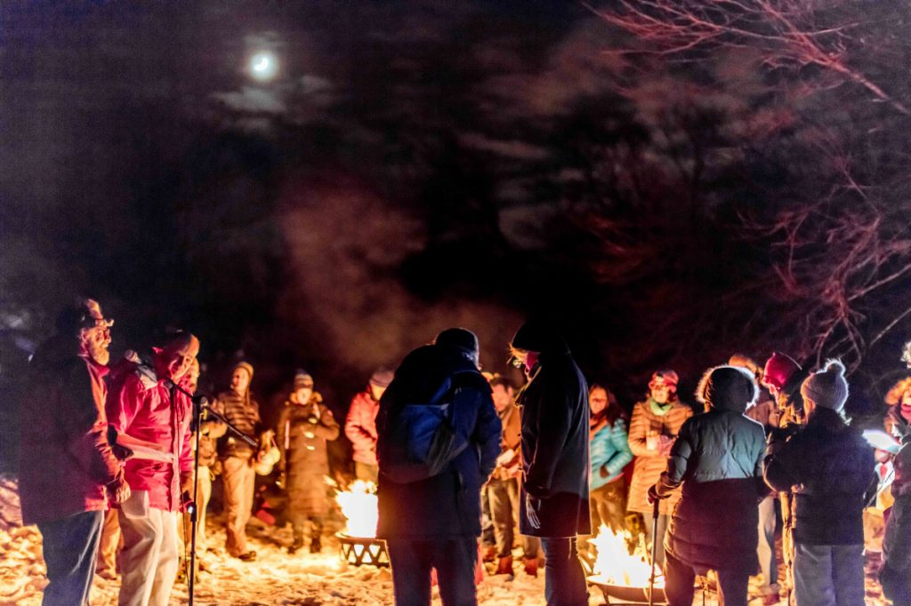 People celebrate a past winter solstice around a fire at Houghton Graves Park on Orr's Island.