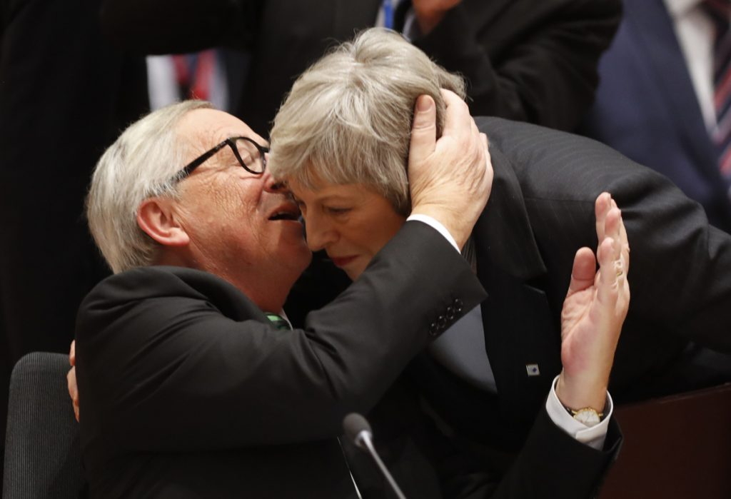 European Commission President Jean-Claude Juncker greets British Prime Minister Theresa May at the EU summit Thursday in Brussels where leaders offered their sympathy over her Brexit predicament.
