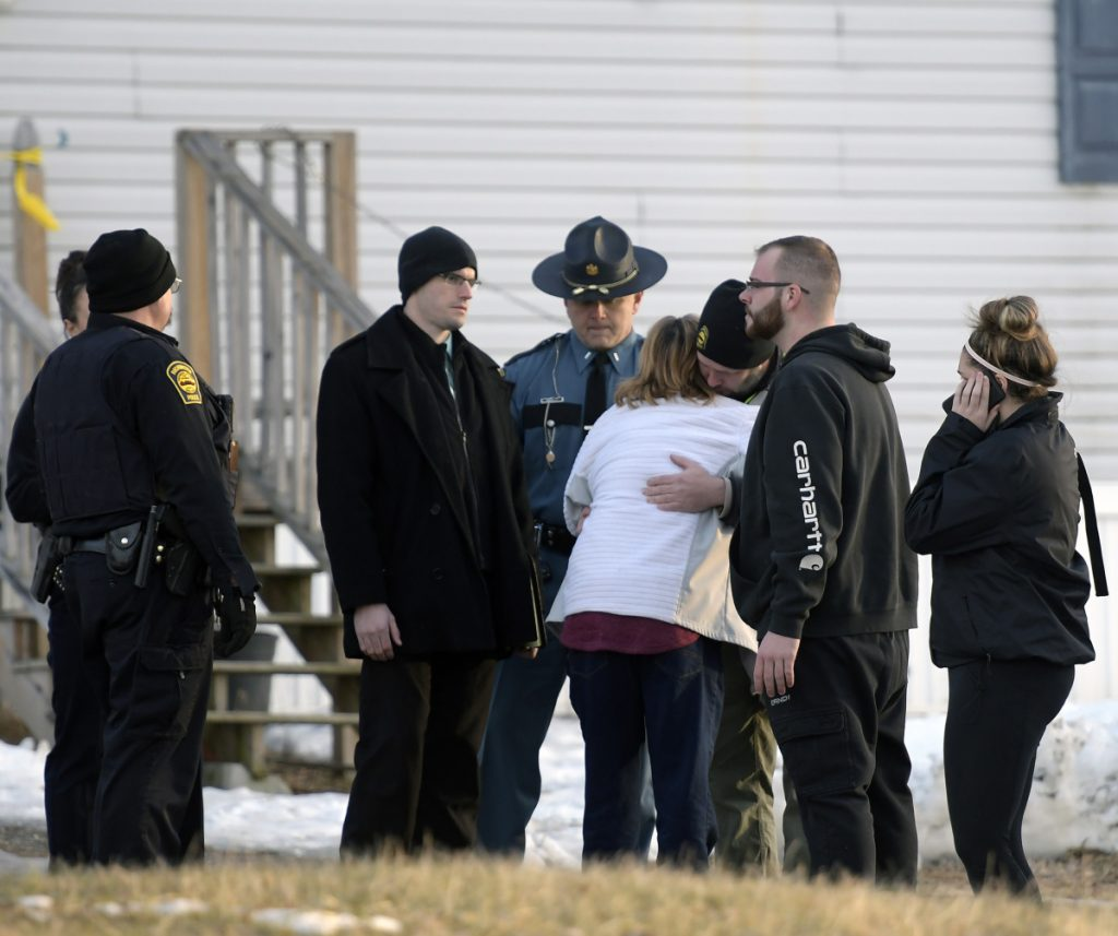 """Richmond Police Chief Scott MacMaster comforts relatives of two people found dead Saturday in a residence on Post Road in Richmond. Police said the deaths were """"not natural"""" but there is no threat."""