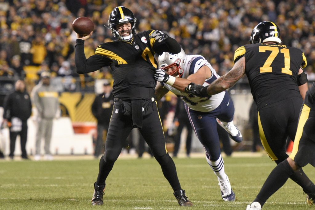 Pittsburgh Steelers quarterback Ben Roethlisberger gets off a pass while New England Patriots middle linebacker Kyle Van Noy tries to tackle him during the second half of the Patriots' 17-10 loss on Sunday in Pittsburgh.