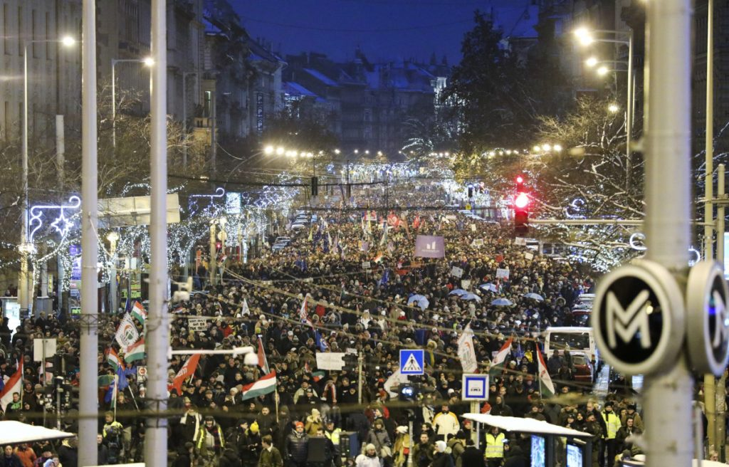 Anti-government demonstrators march under Christmas decorations in the center of Budapest, Hungary, on Sunday. Protesters were demonstrating against recent changes to the nation's labor laws.