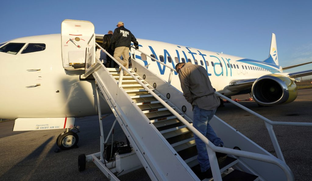 Immigrants who entered the United States illegally are deported on a flight to El Salvador by U.S. Immigration and Customs Enforcement in Houston. An obscure division of the agency operates hundreds of flights each year to remove immigrants.