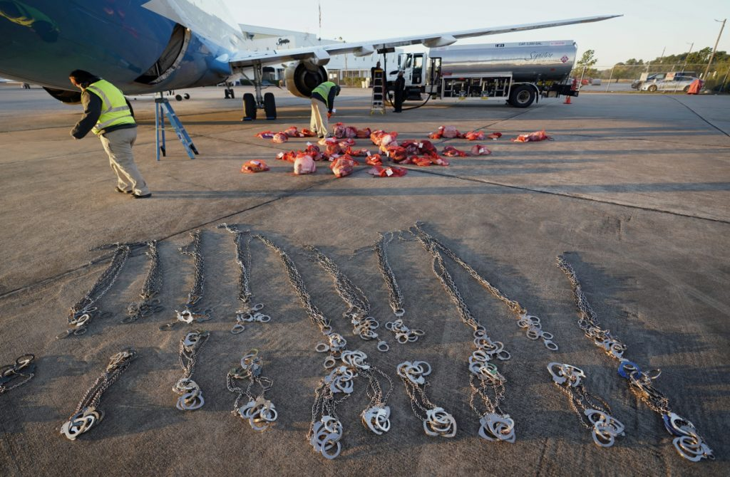 Personal belongings of immigrants who entered the United States illegally are loaded onto a plane for a deportation flight to El Salvador by U.S. Immigration and Customs Enforcement in Houston.
