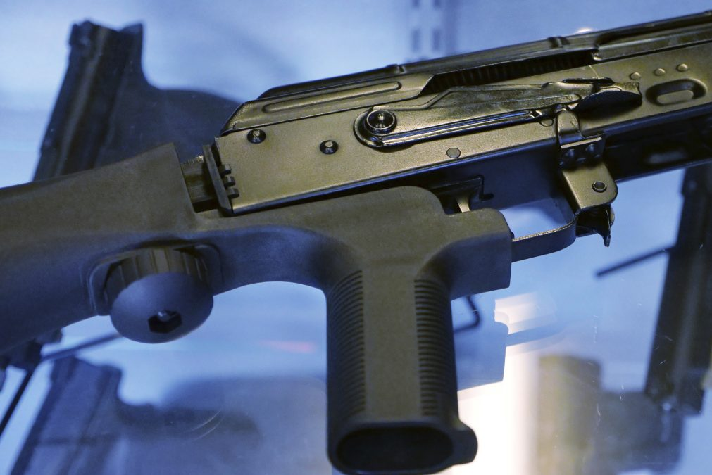 A bump stock is attached to a semi-automatic rifle at the Gun Vault store and shooting range in South Jordan, Utah. The Trump administration is moving to ban bump stocks, which allow semi-automatic weapons to fire rapidly like automatic firearms.