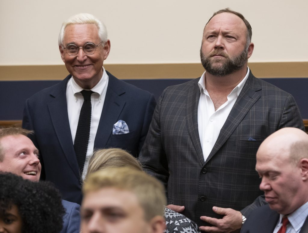 Trump confidant Roger Stone, left, has admitted that he spread false information on the website Infowars, founded by conspiracy theorist Alex Jones, right.