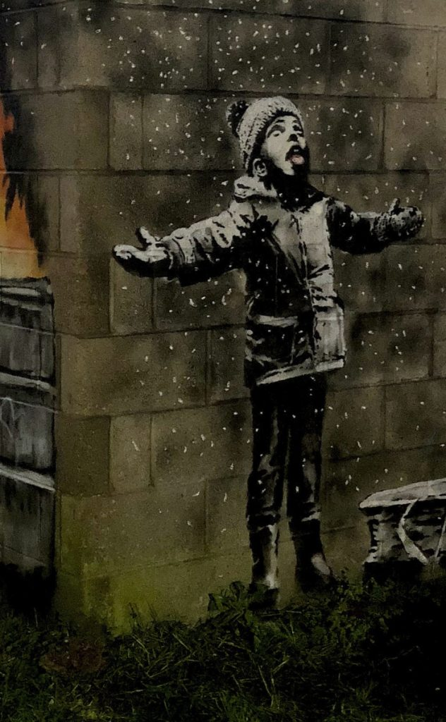 Twitter/@RHoneyJones via AP The snowflakes depicted by Banksy on a garage in Port Talbot, Wales, are actually ashes referencing dirty air.
