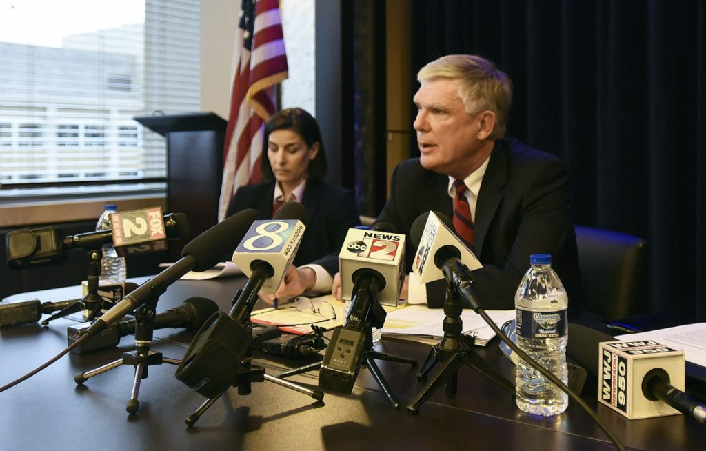 Special counsel Bill Forsyth, right, answers questions Friday during a news conference in Lansing, Mich., regarding the independent special counsel's investigation into Michigan State University's handling of the sexual abuse scandal involving disgraced former sports doctor Larry Nassar. Assistant Attorney General Christina Grossi is at left.