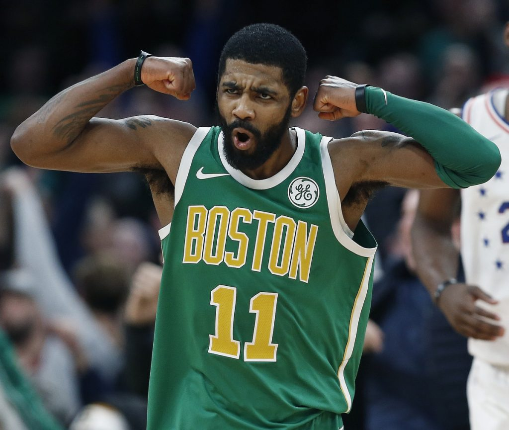 Kyrie Irving celebrates after making a 3-pointer in overtime during Boston's 121-114 win Tuesday against the Philadelphia 76ers. Irving finished with 40 points and 10 rebounds.