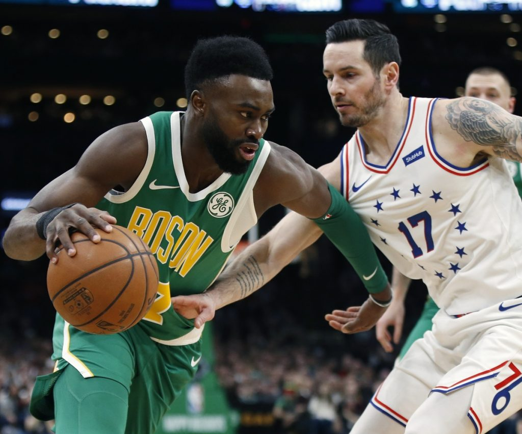 JJ Redick, right, of the 76ers tries to poke the ball away from Boston's Jaylen Brown.