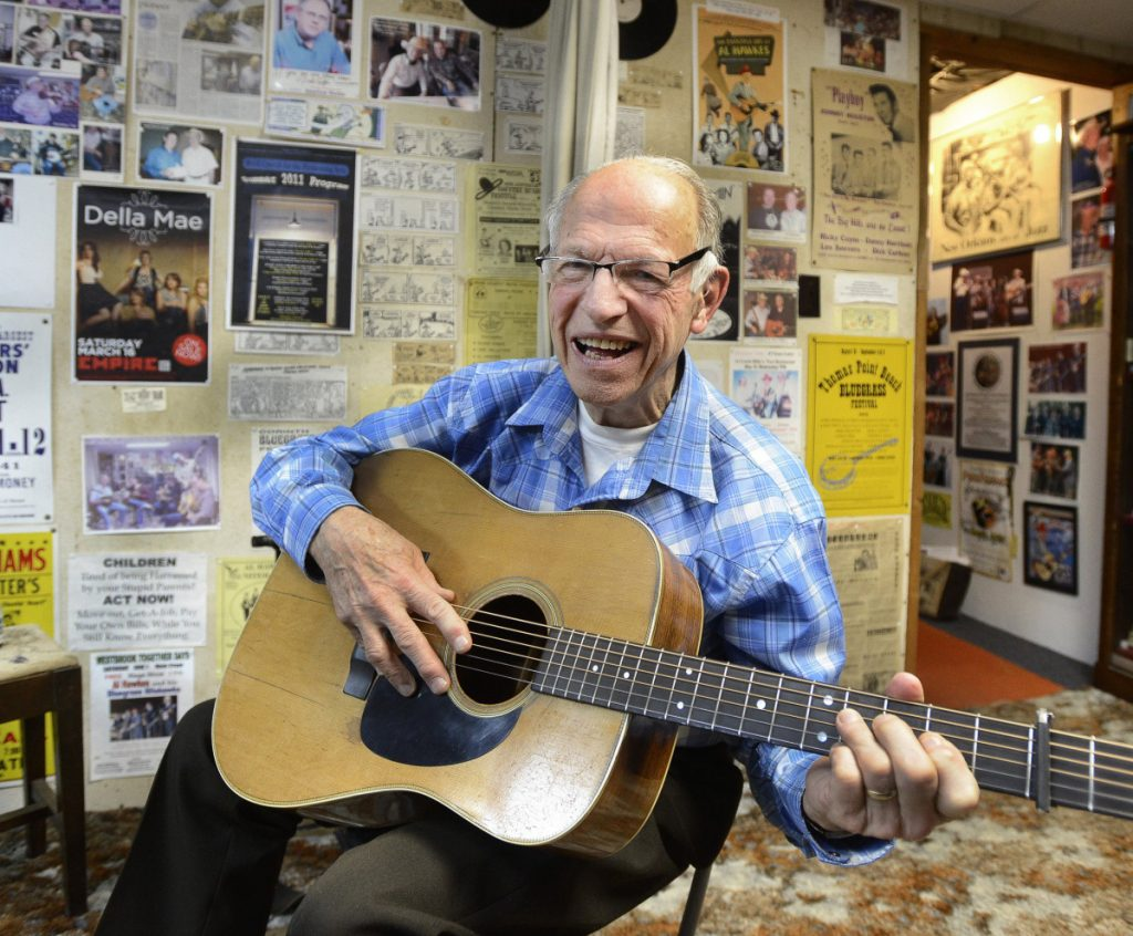 Maine bluegrass pioneer Al Hawkes plays guitar in his home studio in Westbrook in 2015. The man who 56 years ago built a 13-foot-tall TV repairman for the sign of his Route 302 shop turned 88 on Christmas Day, and died Friday.