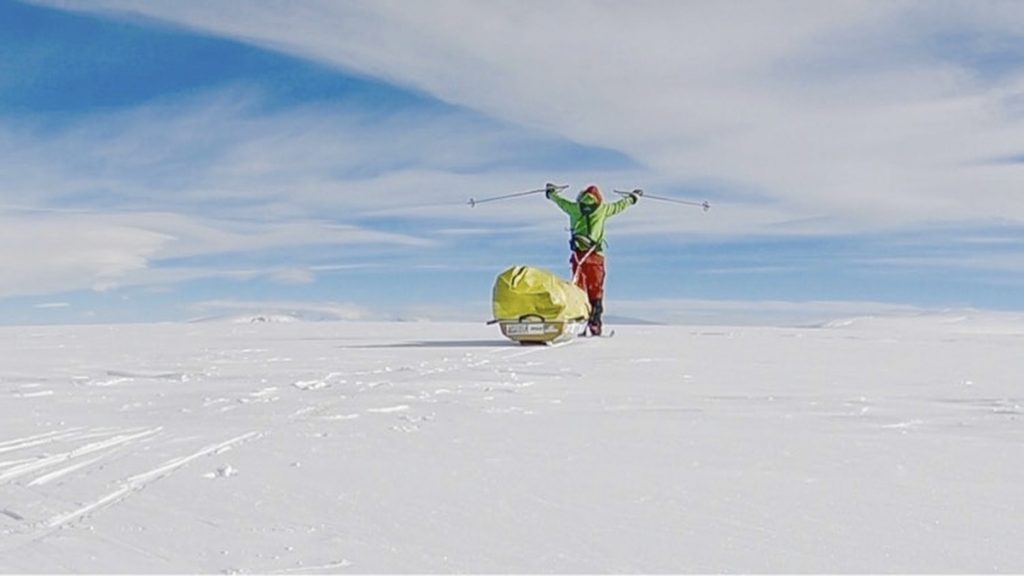 In this photo provided by Colin O'Brady, of Portland., Ore., he poses for a photo while traveling across Antarctica on Wednesday, Dec. 26, 2018. He has become the first person to traverse Antarctica alone without any assistance. O'Brady finished the 932-mile (1,500-kilometer) journey across the continent in 54 days, lugging his supplies on a sled as he skied in bone-chilling temperatures.