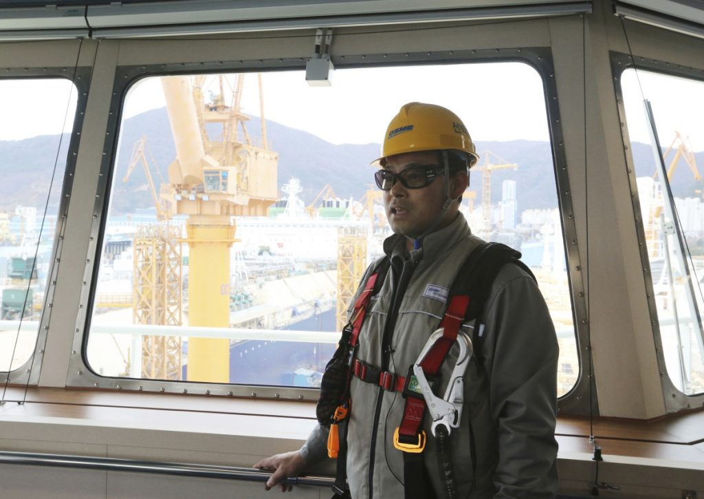"In this Friday, Dec. 7, 2018 photo, Song Ha-dong, a senior official from Daewoo Shipbuilding and Marine Engineering, speaks during an interview on the building of a large-sized liquefied natural gas (LNG) carrier at the Daewoo Shipbuilding and Marine Engineering facility in Geoje Island, South Korea. ""The U.S.-led shale gas boom is getting fully under way and China, Japan and South Korea are increasing their consumption of natural gas,"" he said. (AP Photo/Ahn Young-joon)"