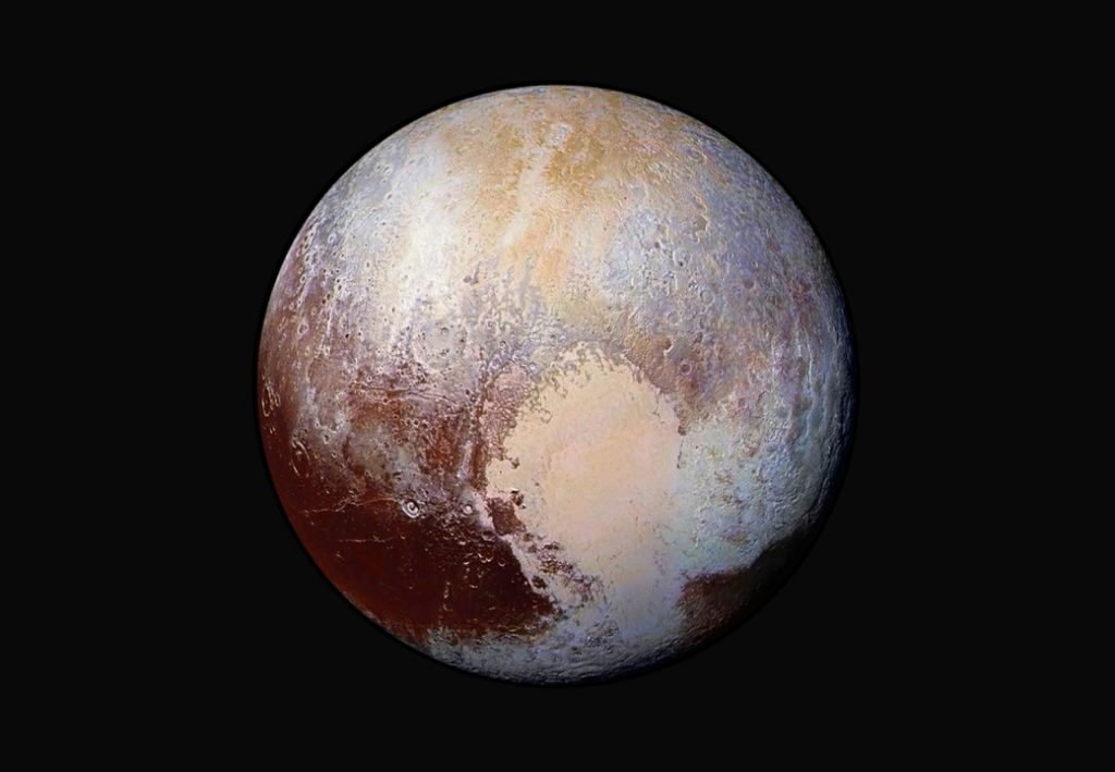 FILE - This image made available by NASA on Friday, July 24, 2015 shows a combination of images captured by the New Horizons spacecraft with enhanced colors to show differences in the composition and texture of Pluto's surface. The images were taken when the spacecraft was 280,000 miles (450,000 kilometers) away. (NASA/JHUAPL/SwRI via AP)