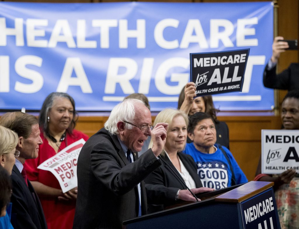 Sen. Bernie Sanders, I-Vt., center, accompanied by Sen. Kirsten Gillibrand, D-N.Y., center right, explain a Medicare for All bill that they supported in 2017.