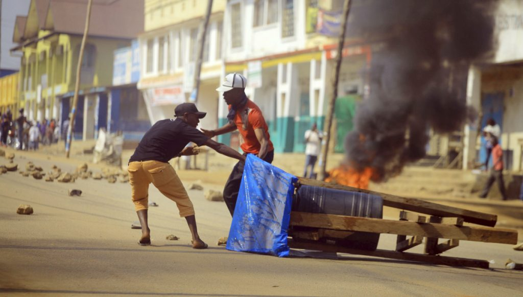 Protesters set up a barricade in the eastern Congolese town of Beni on Thursday. Police fired live ammunition and tear gas to disperse dozens of people protesting a presidential election delay.