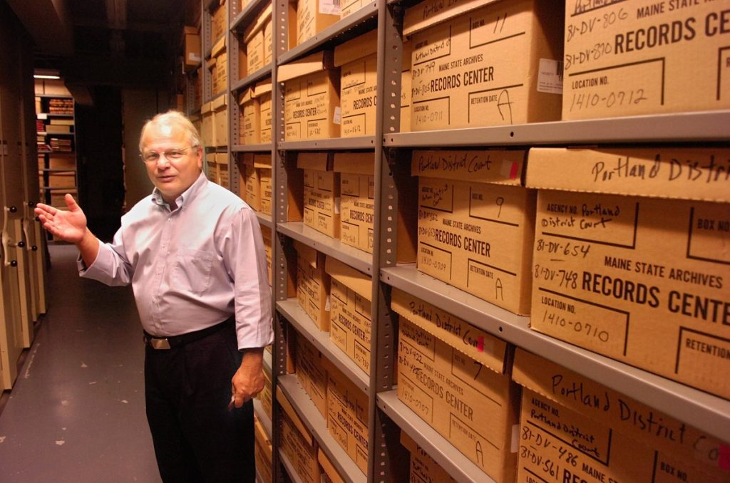 """""""Accessing anything that's on the backup tapes would be a fairly labyrinthine effort ... and could wind up being fruitless,"""" says Maine State Archivist David Cheever. He is shown here in the archives in 2015."""
