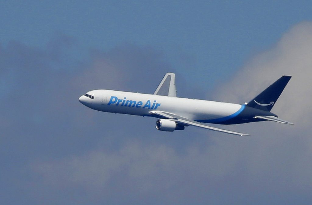 "A Boeing 767 with an Amazon.com ""Prime Air"" livery flies over Lake Washington on August 5, 2016.   The online retailer says it will lease 10 Boeing 767s planes, which will bring its total aircraft fleet up to 50."