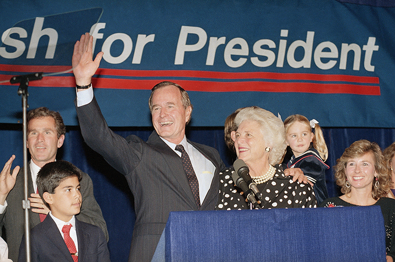 Vice President George Bush and wife, Barbara, wave to supporters who turned out in Houston on Oct. 12, 1987, to hear him announce he was a candidate for the Republican nomination for president of the United States.