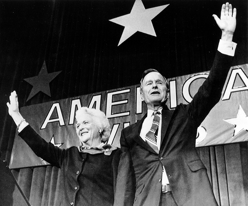 The new president of the U.S. George Bush and his wife Barbara wave to supporters in Houston, Texas Tuesday evening November 8, 1988 after winning the presidential elections. The Associated Press