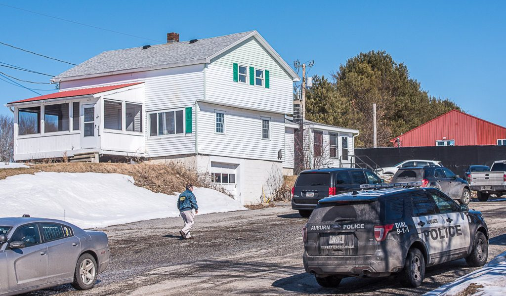 An IRS investigator walks up the driveway of Tyler Poland's home and office on Merrow Road in Auburn during the February drug bust in Lewiston and Auburn.