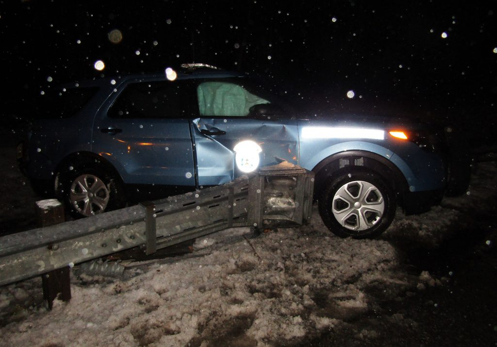 State police say Trooper Ryan Keller was parked in the breakdown lane on the Maine Turnpike in New Gloucester when a car driven by Nancy Colson, 22, of Topsham hit the rear of the cruiser, forcing it into a guardrail.