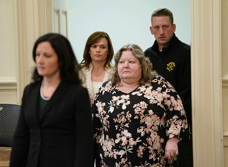 Kandee Collind, right, enters York County Superior Court in Alfred on Thursday with her attorneys Molly Butler Bailey, left, and Heather Gonzales. The receipt of new evidence in the case led the judge to continue the hearing until January.