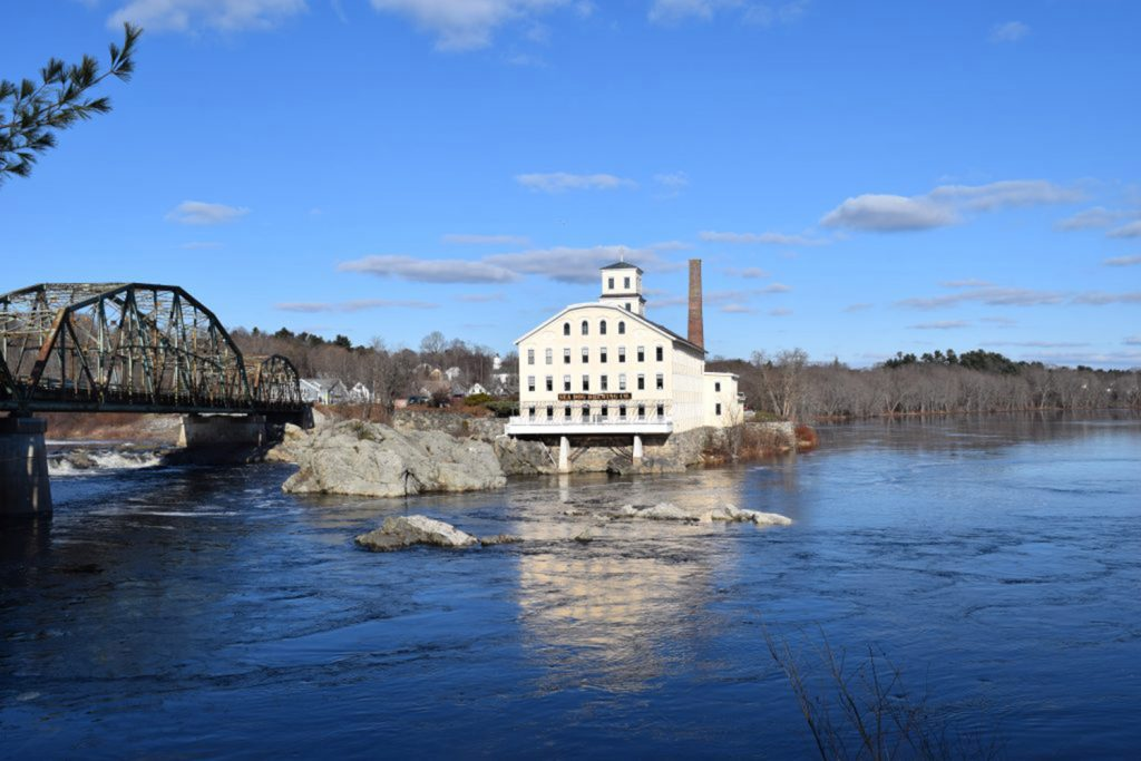 Brunswick firefighters pulled a woman from the Androscoggin River on Wednesday.