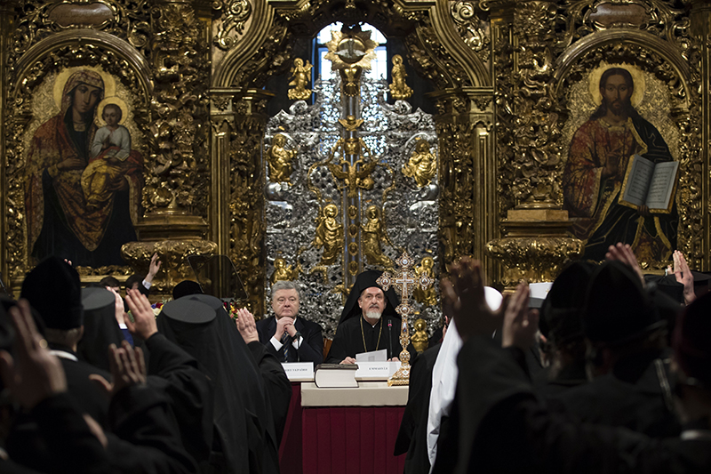 Ukrainian President Petro Poroshenko, center left, attends a closed-door synod of three Ukrainian Orthodox churches to approve the charter for a unified church and to elect leadership in the St. Sophia Cathedral in Kiev on Saturday.