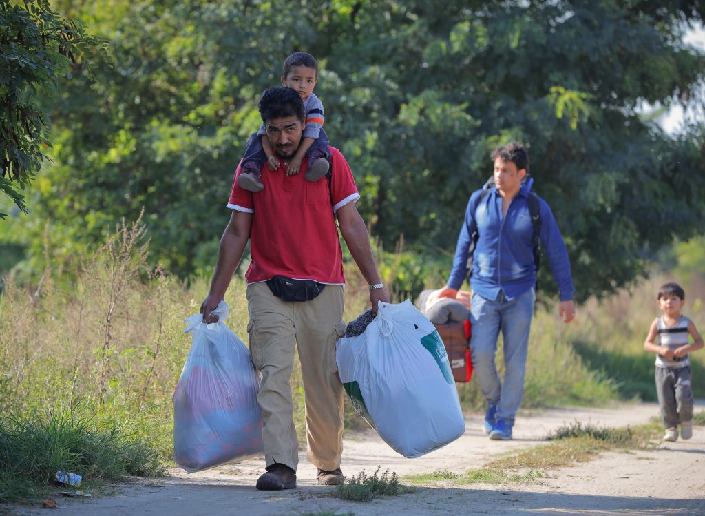 Migrants walk to a makeshift camp in Horgos, Serbia in September, 2016.