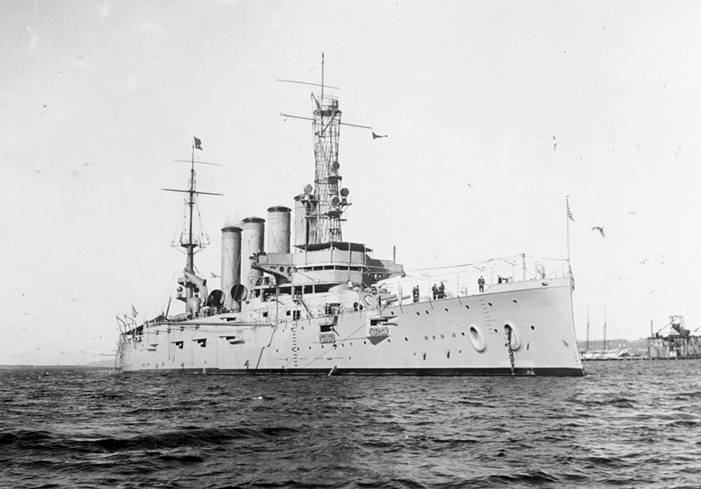 This Jan. 28, 1915 made available by the U.S. Naval History and Heritage Command shows the USS San Diego while serving as flagship of the Pacific Fleet. Her name had been changed from California in September 1914. On a clear summer day, July 19, 1918, an external explosion near the ship's engine room shook the armored cruiser. Water soon rushed into the hull. Within minutes, the 500-foot warship began to capsize. Weighed down with 2,900 tons coal for a planned voyage across the Atlantic Ocean, the vessel sank in just 20 minutes. Six crew members perished. (U.S. Naval History and Heritage Command via AP)