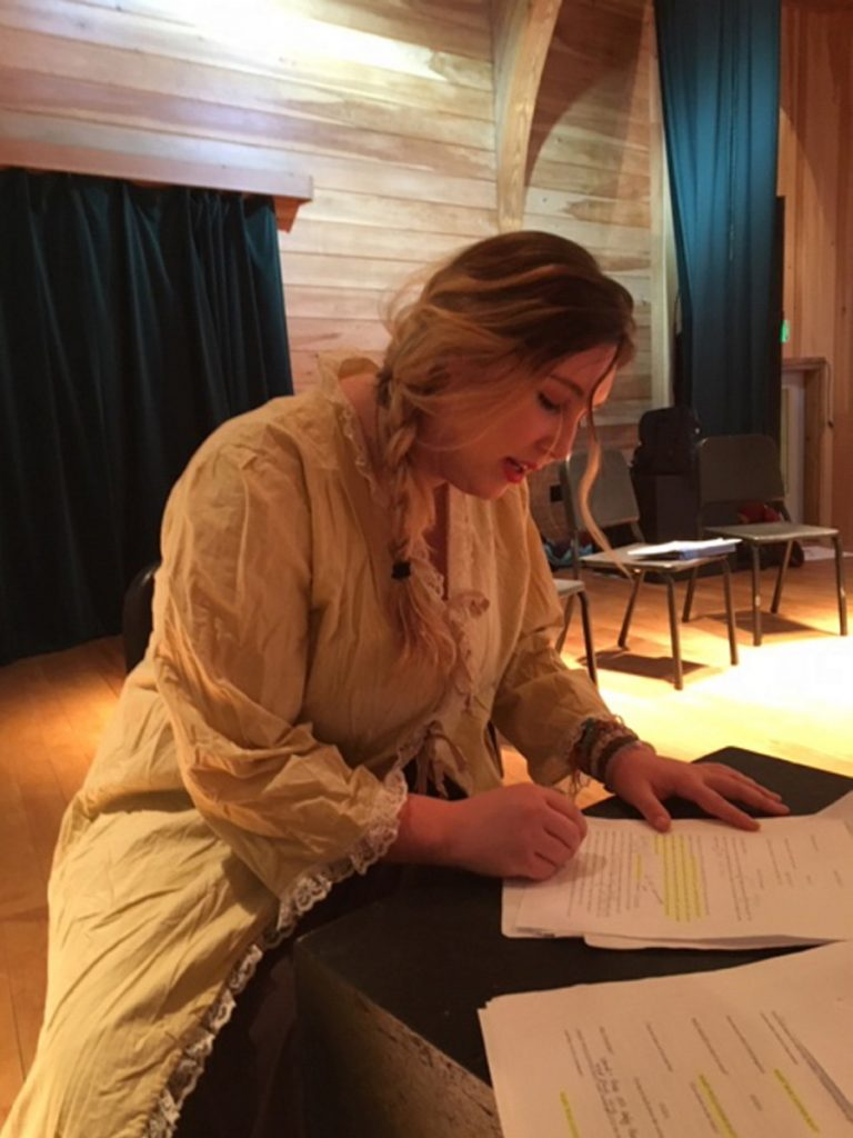 """Carli Negron-Maron, who plays Mary Wollstonecraft in the play """"Mary, Mary,"""" is editing her script at Maine Arts Academy in preparation for the one-act performances."""