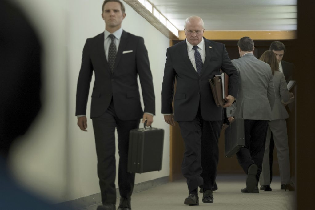 "Christian Bale, center, as Dick Cheney in Adam McKay's ""Vice."""