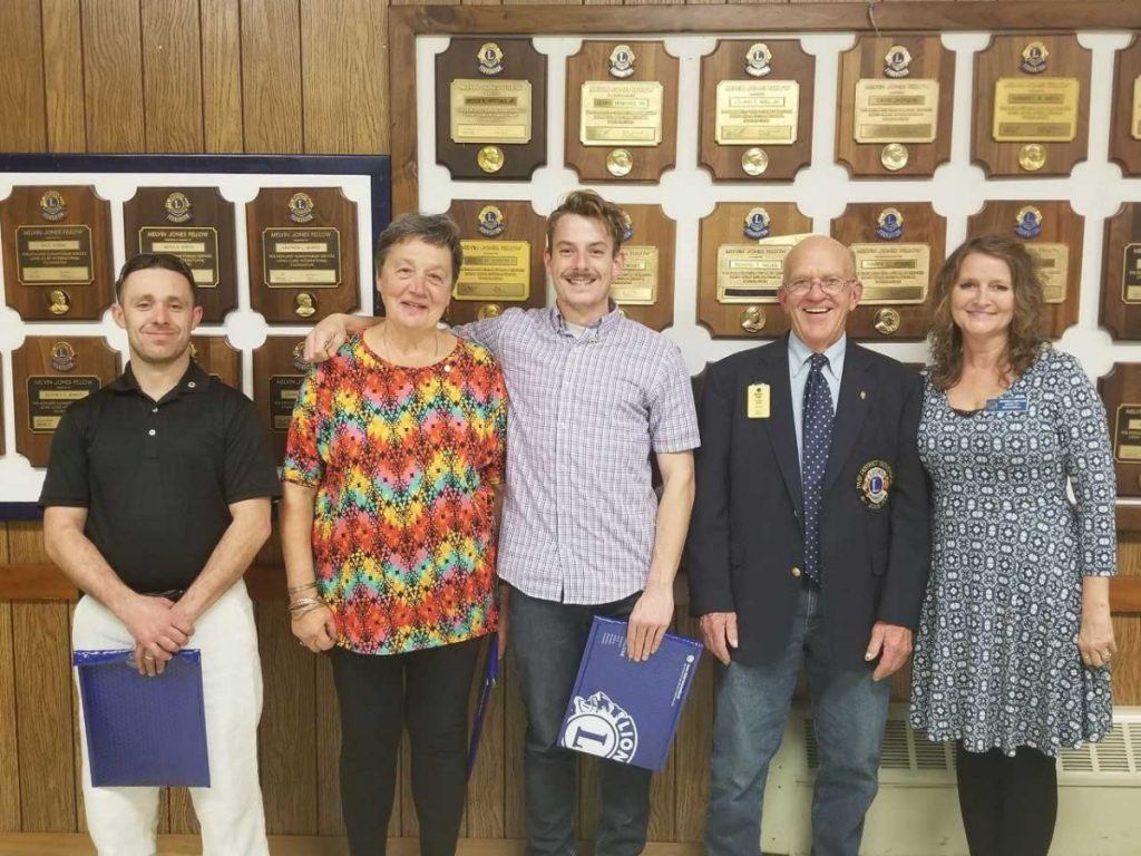 The new members of the Whitefield Lions Club from left are Justin Lyshon, Fran Randall and Ben Stratton, with Past District Governor Tim Chase, and Whitefield Lions Club President Kim Haskell.