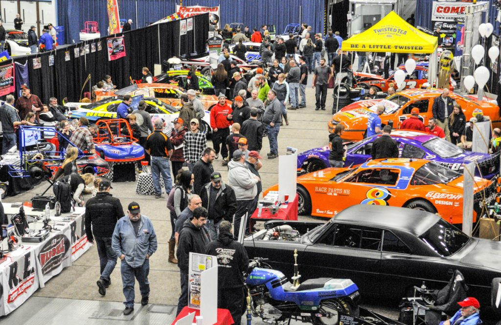 People walk past displays during the Northeast Motorsports Expo last year at the Augusta Civic Center.