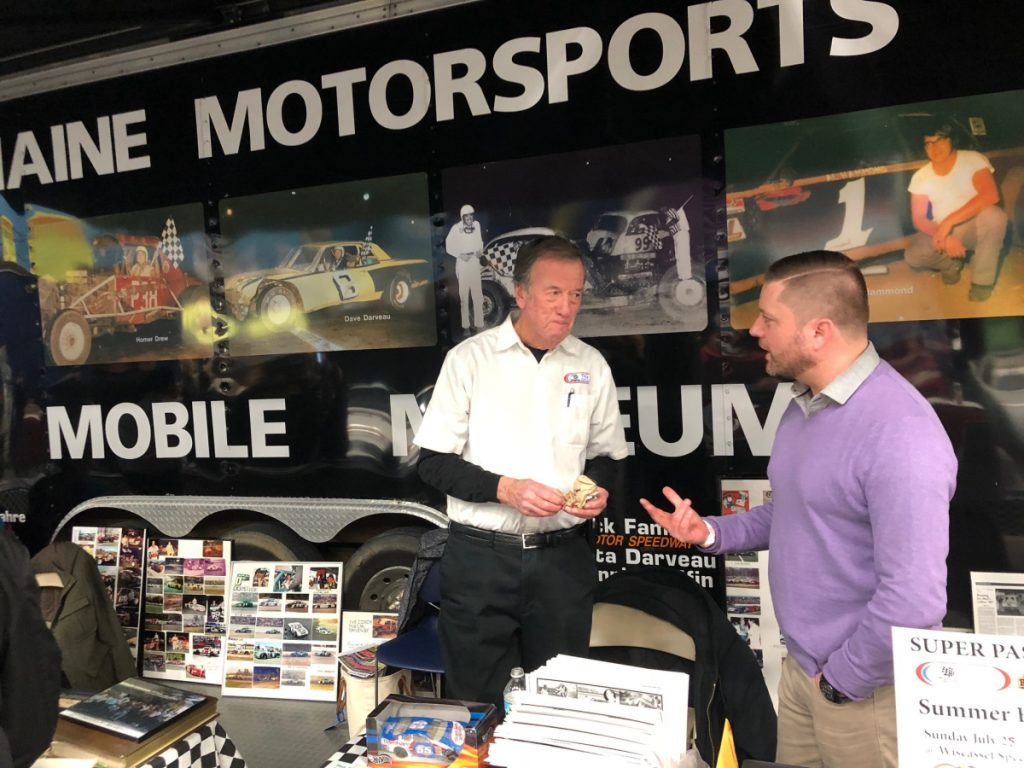 Standing next to the Maine Motorsports Mobile Museum on Saturday, Maine Vintage Race Car Association president Andy Austin, right, talks with board member Bruce Elder at the Northeast Motorsports Expo at the Augusta Civic Center.