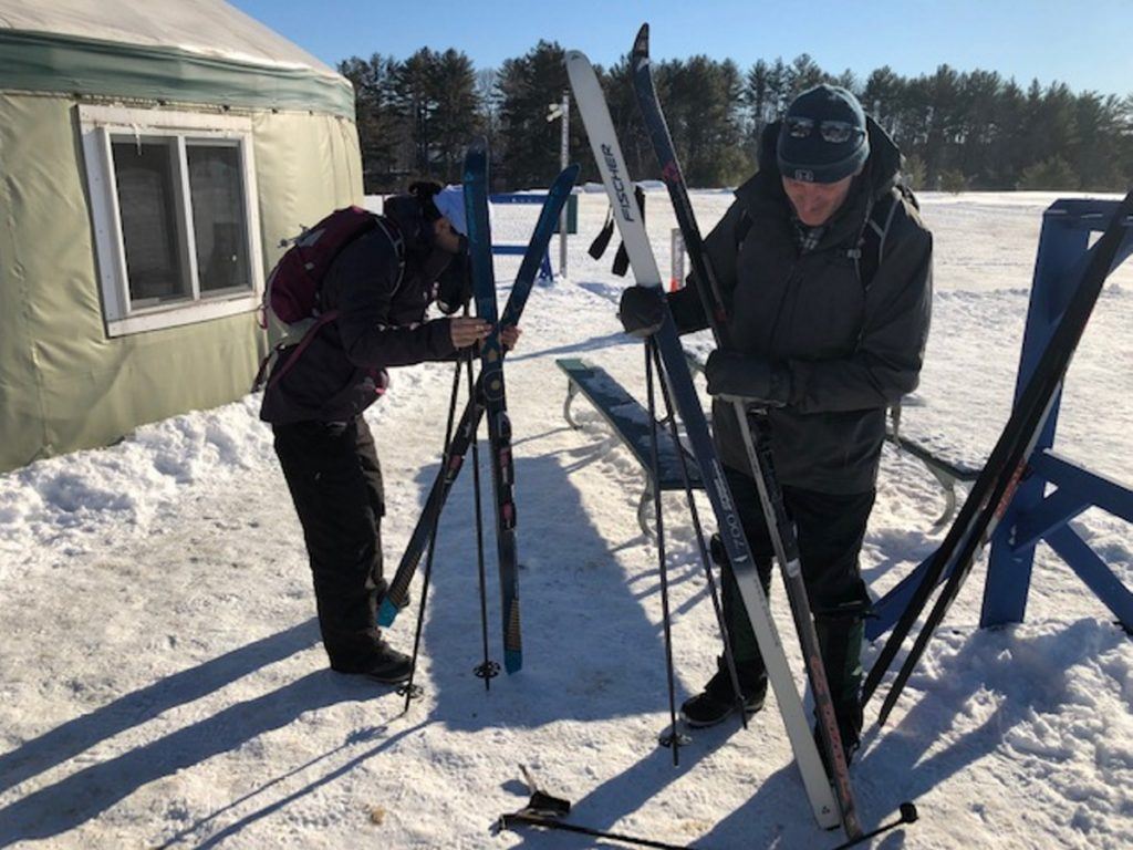John Elliot, right, and April Lawrence, both of Belfast, gear up for some skiing Saturday at Quarry Road Trails in Waterville.