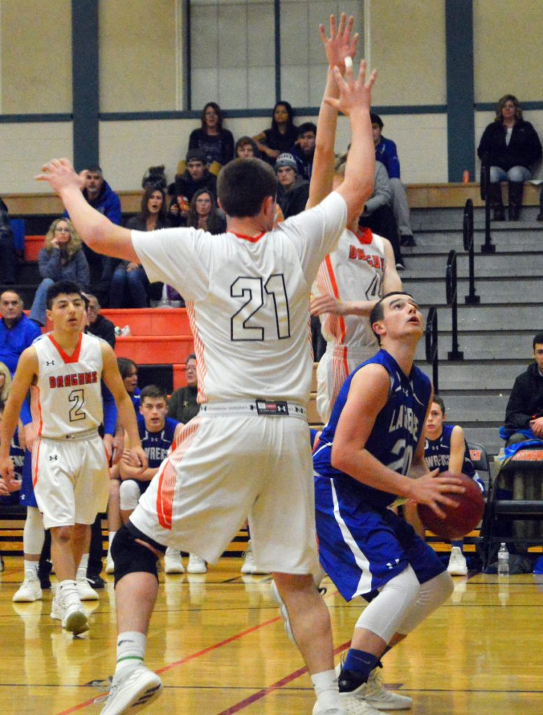 Lawrence's Gavin Herrin, right, looks to the basket as Brunswick's Sam Sharpe (21) defends during a game Tuesday night at Brunswick. The host Dragons rolled to a 60-42 victory over the Bulldogs, who fell to 5-5.