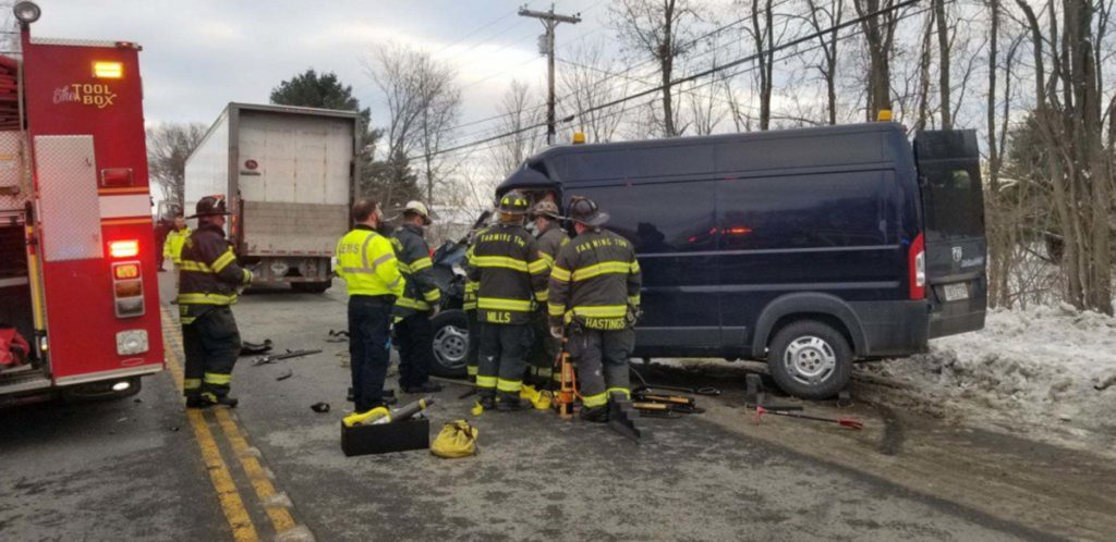 Farmington police, fire and rescue personnel assist at a rear-end collision between a state highway department van and a UPS tractor-trailer truck on Route 2 in Farmington on Tuesday afternoon. Aaron Buotte, 32, of Manchester was flown to a Lewiston hospital with serious injuries, police said.